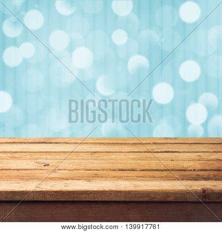 Winter bokeh background with empty wooden deck table. Christmas background. Ready for product montage display
