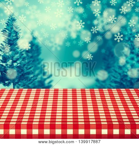 Winter background with empty table covered with checked tablecloth. Ready for product montage display