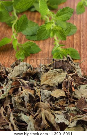 Heap Of Dried And Fresh Lemon Balm On Wooden Table, Herbalism