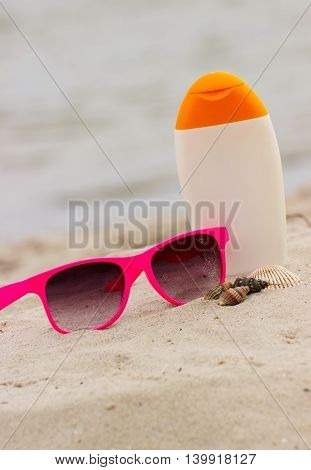 Seasonal Concept, Shells, Pink Sunglasses And Sun Lotion