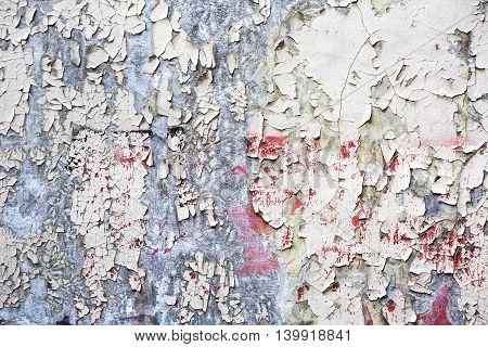 Old White Peeled Paint Remain On Plaster Wall