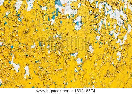 Abstract Yellow Background Of Rusty Wall With Peeling Paint