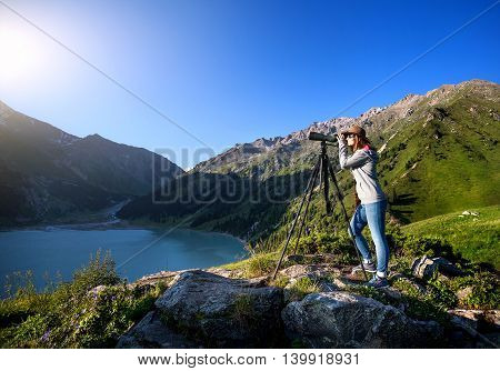 Tourist Woman At The Mountains At Sunrise