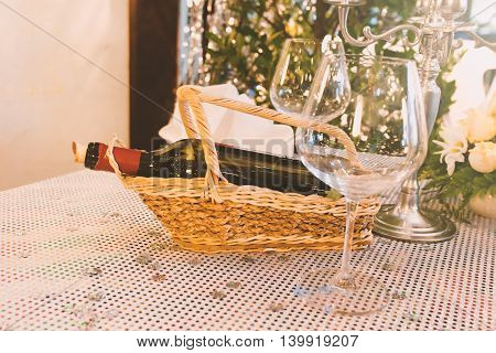 Bottle Of Wine On Wood Basket And Glasses On Table