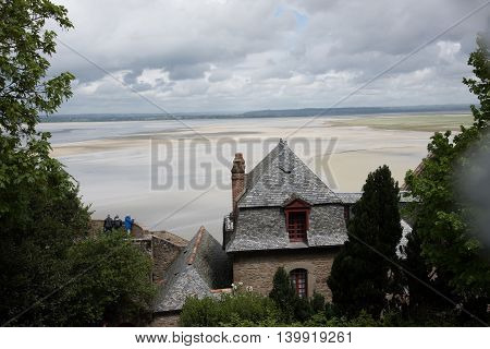 Tourist overviewing surrounding from Mont Saint-Michel Normandy France