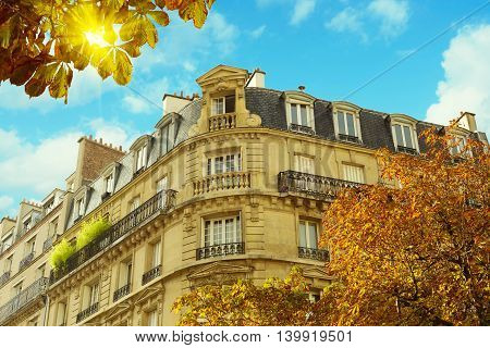 Historic building in Paris France over cloudy blue sky