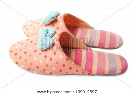 Cute funny pink striped dotted girl clown slippers with blue bow isolated on white side view
