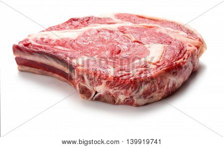 big raw rib-eye steak isolated on white background