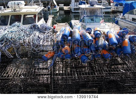 Lobster traps and boats at Kings Harbor, Redondo Beach, California.