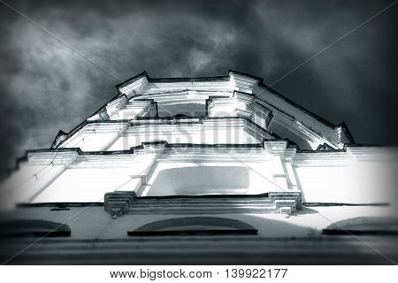 Bell tower of Spaso-Prilutsky Monastery in the Vologda city, Russia. Unusual view. Monochrome dramatic image