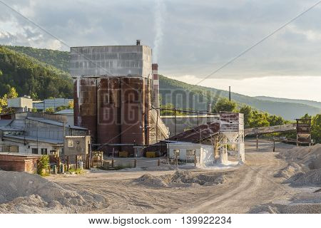 Small dirty old cement plant in the evening