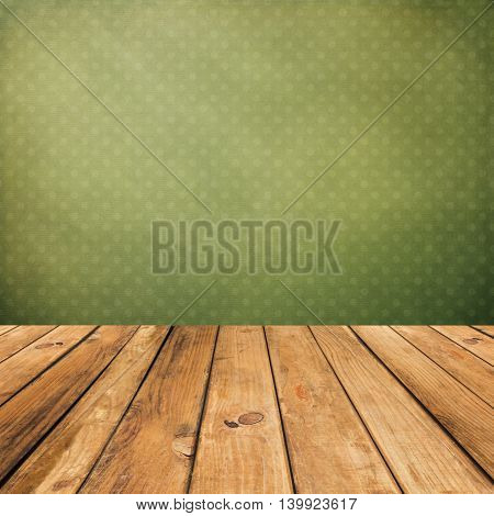 Vintage wooden planks over grunge green background