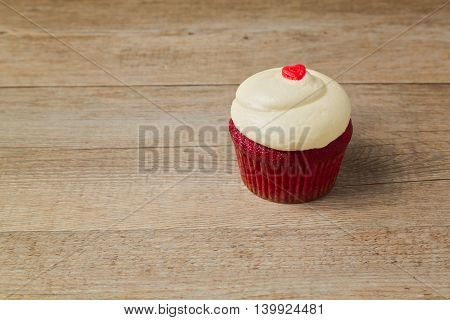 Cupcake with heart shape candy. Valentine's day background