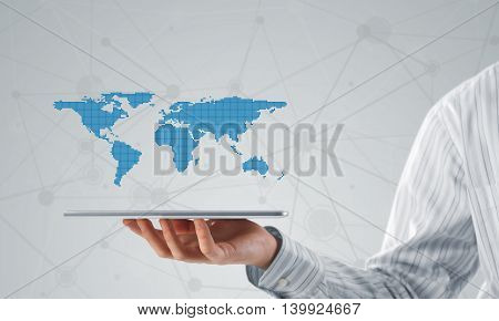 Close view of businessman holding tablet pc and presenting global connection concept
