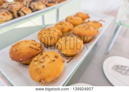 Chocolate chip muffins on table in buffet