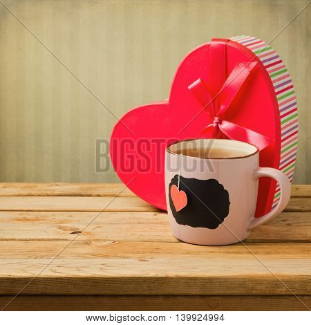 Cup of tea with heart shape and gift box. Valentine's day background