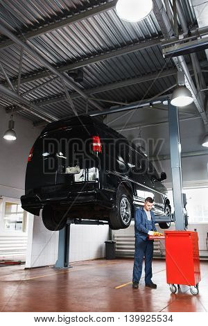 Repair shop for minibuses, car maintenance. Professional workshop for auto service