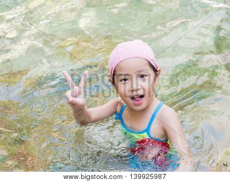Asian Girl Is Playing In The Pool, Victory Fingers