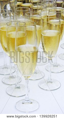 Several white champagne vine glasses. Wedding abstraction.