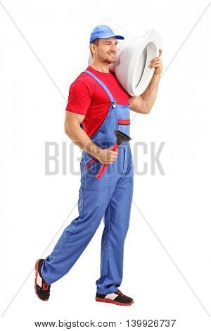Full length portrait of a cheerful male plumber carrying a toilet and a plunge isolated on white background