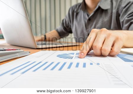 businessman analyzing investment charts Accounting and Business concept soft focus vintage tone