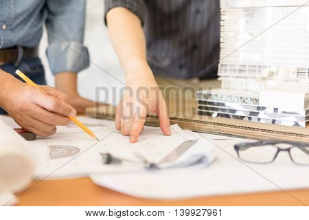 business architect drawing on blueprint architectural concept