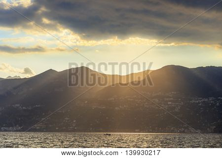 Sunset on the Amalfi Coast.Italy(Campania, Costiera Amalfitana). Ray of sunlight illuminates the mountains overlooking the sea.