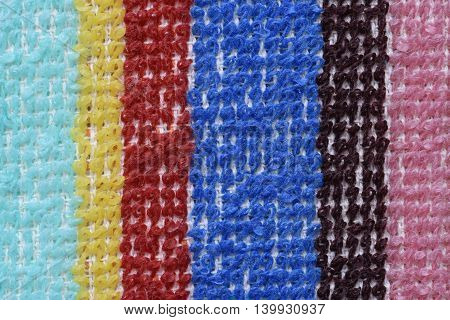 Multicolored fabric stripes for washing dishes as background