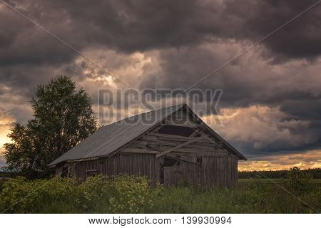Stormy Clouds Over The Barn House