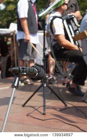 The microphone on the outdoor concert. Detail microphone on the musical stage. Music group performances.