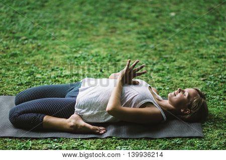 Yoga WOman Meditating knees bent hands in prayer position