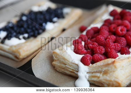 Fresh berry dessert on a baking tray