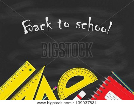 Back to school concept, school items placed on the bottom of black blackboard.