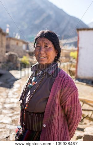 Jhong, Nepal - May 13, 2016: Portrait of an unidentified tibetan woman in the Himalayas mountains in Jhong village, Nepal.