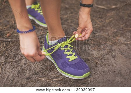 Runner Woman Tying Shoelaces. Tie Shoelaces