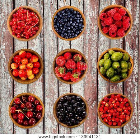 Set various berries. Strawberries currant cherry raspberries gooseberries and bilberry.