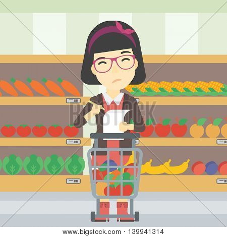 An asian thoughtful woman standing at the supermarket with supermarket trolley full with products and holding a shopping list in hands. Vector flat design illustration. Square layout.