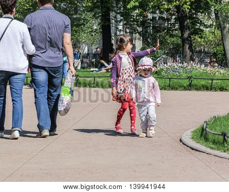 St. Petersburg, Russia - 9 May, Children in the garden, 9 May, 2016. Vacationers people on the lawns and gardens in the city.