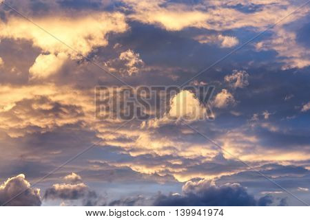 Clouds illuminated by the evening sun. Clouds in the sky during the day and evening.
