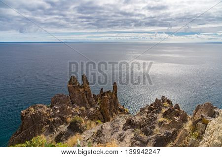 Cliff edge against cloudy sky and Atlantic ocean danger precipice