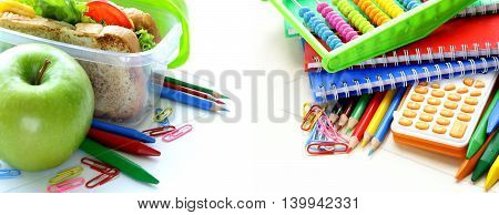 school stationery and lunch box with an apple and sandwich