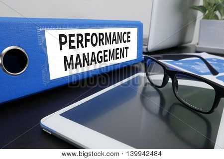 PERFORMANCE MANAGEMENT Office folder on Desktop on table with Office Supplies. ipad