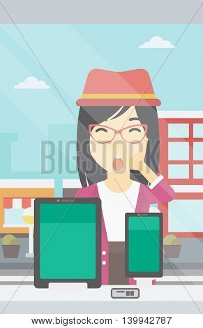 Astonished woman looking at digital tablet and smartphone through shop window. An asian young woman with open mouth looking at tablet and phone. Vector flat design illustration. Vertical layout.