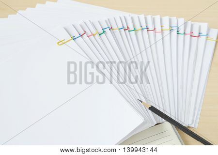 Pencil With Notebook And Colorful Paperclip With Paperwork And Reports