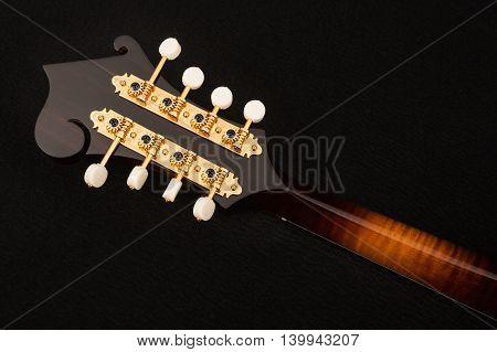 Mandolin isolated on black background, back side