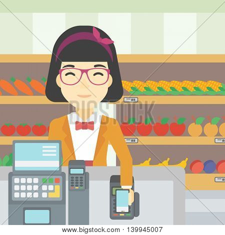 An asian young woman paying wireless with smartphone at the supermarket checkout . Female customer making payment for purchase with smartphone. Vector flat design illustration. Square layout.