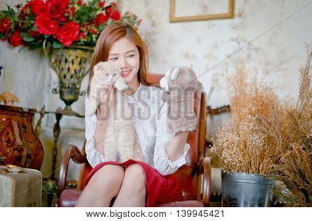 Cute Girl And Cat Playing With Sock Puppets