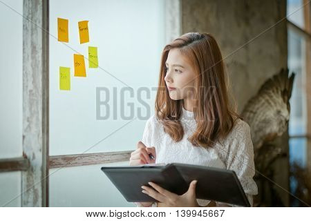 Portrait Of A Beautiful Young Woman Thinking,