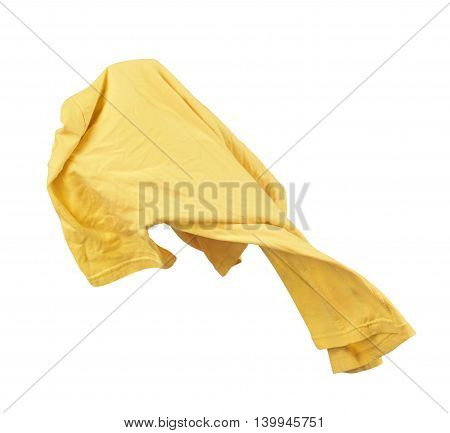 Blank yellow shirt are falling through the air on an isolated white background.