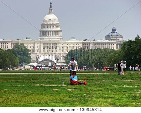 WASHINGTON, USA - MAY 27, 2010: People are resting near United States Capitol building in Washington DC, USA